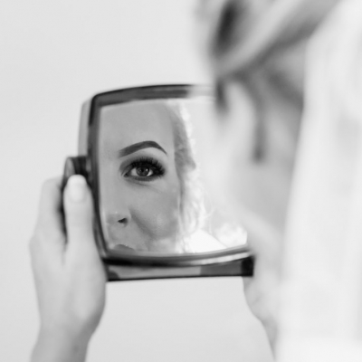 Woman with Lash Extensions looking in a mirror