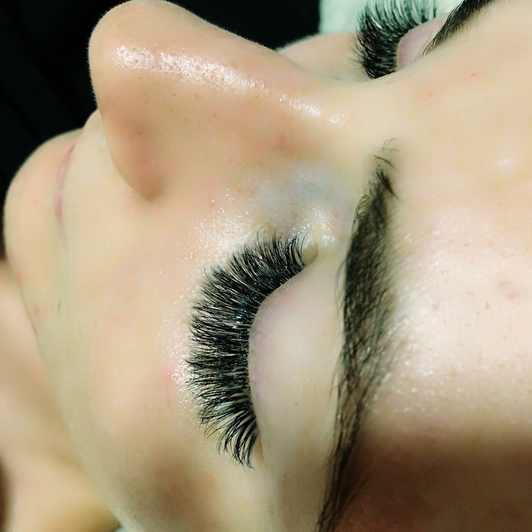 Close up of a woman with Eyelash Extensions and Closed Eyes