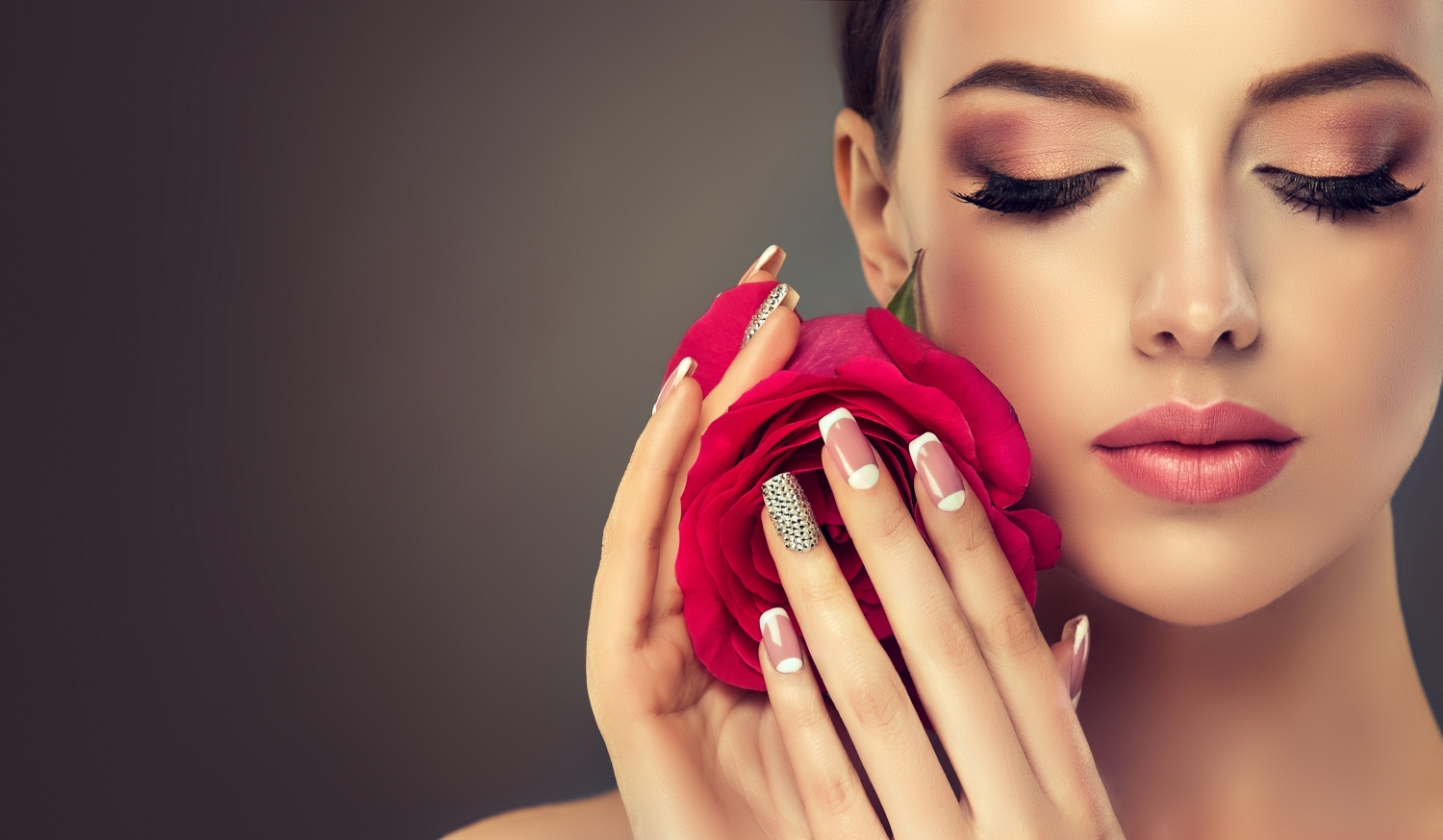 Woman with beautiful makeup and manicure