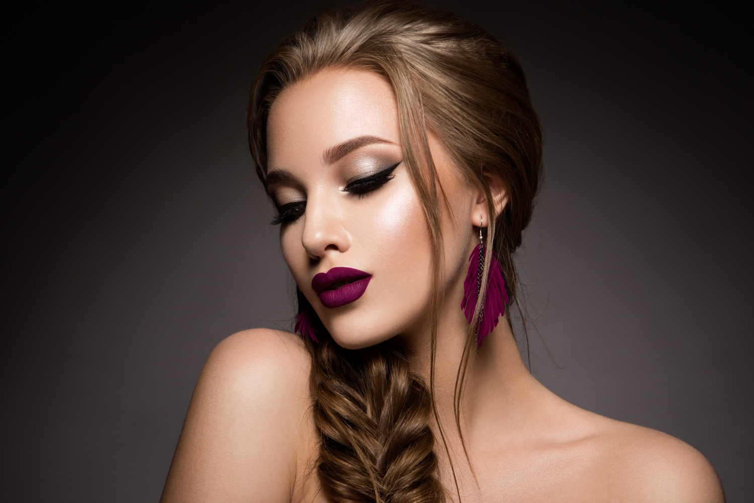 Woman with beautiful hair do, makeup and lash extensions
